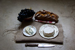 Wine, bread and cheese Stock Photography
