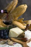 Wine and Bread with a glass of wine 1. Assorted Breads and cheese and a glass of Chianti Wine stock photo