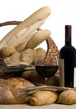 Wine with Bread Isolated 2. A glass of red wine with an assortment of breads isolated on white Royalty Free Stock Images