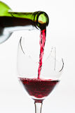 Wine in the the broken glass stock image