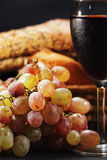 Wine and bunch of grapes royalty free stock photos