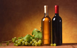 Wine with bunch of grapes Stock Photos