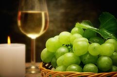 Wine candle and grapes stock images