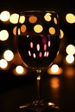 Wine by candlelight. A romantic evening with wine and candles Stock Images