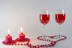 Wine and candles. On a white background are glasses of wine and candles Royalty Free Stock Images