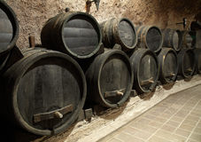 Wine cask. In the dark winery basement royalty free stock photo