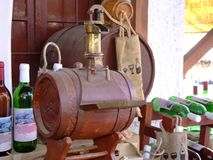Wine cask. With interesting pump for to make wine and flagons royalty free stock photography