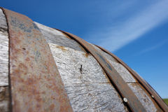 Wine Cask. Close up of a wooden wine cask set against a blue sky royalty free stock photography