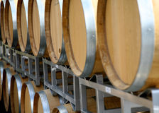 Wine Casks. Full of wine on a rack at a winery Royalty Free Stock Image