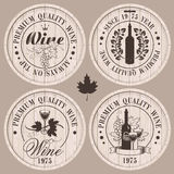 Wine casks. Four labels for wine on wooden casks Royalty Free Stock Image