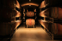 Wine cellar. Wine barrels stacked in a cellar. Also available in vertical Royalty Free Stock Photos