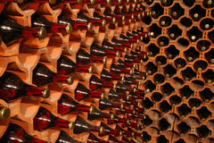 Wine cellar. Racks with bottles in a dark wine cellar Royalty Free Stock Photography