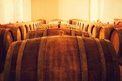 Wine Cellar. Three rows of casks in a wine cellar Stock Photo