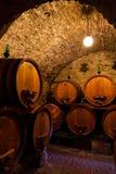Wine cellar. Dark wine cellar with barrels of wine Royalty Free Stock Photography