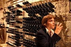 Wine cellar. A man in a wine cellar Royalty Free Stock Photos