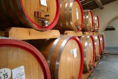 Wine Cellar. Barrels of chianti in an Italian wine cellar royalty free stock image