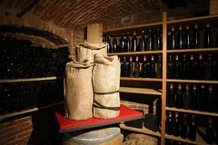 wine cellar with wine, barrels and sacks royalty free stock images