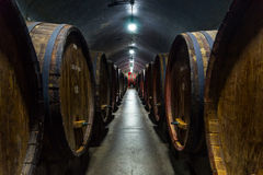 Wine cellar. Wine barrels stacked in a cellar. Also available in vertical, Antique Wine Cellar with Wooden Barrels Royalty Free Stock Photo