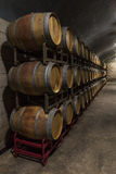 Wine cellar. Wine barrels stacked in a cellar. Also available in vertical, Antique Wine Cellar with Wooden Barrels Royalty Free Stock Photography