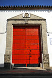 Wine cellar, Bodega, Sanlucar de Barrameda, Cadiz, Spain. Red door of a wine cellar, bodega, where is produced the famous wine called Manzanilla, Sanlucar de Stock Images