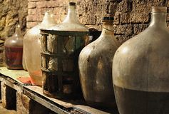 Wine cellar and carboys Stock Images