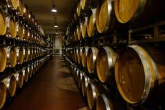 A wine cellar full of oak barrels royalty free stock photo