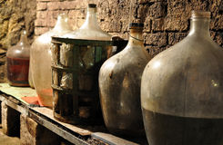 Wine cellar and glass carboys Royalty Free Stock Photo