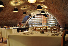 Wine cellar gourmet restaurant. Modern interior design. Contemporary restaurant and wine cellar interior design. Underground arched cellar transformed into a Stock Image