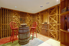 Wine cellar interior in basement room. Royalty Free Stock Photography