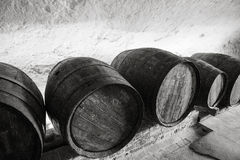 Wine cellar. Line of wooden  barrels in a cellar Royalty Free Stock Photos