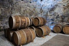 Wine cellar with oak barrels Royalty Free Stock Photo