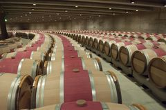 Wine cellar Opus One, Napa Valley, USA. Very modern wine cellar with oak barrels in Napa Valley, California stock photos