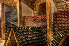Wine cellar, a row of champagne bottles Royalty Free Stock Image