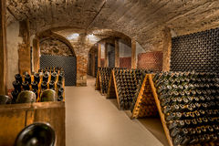 Wine cellar, a row of champagne bottles Royalty Free Stock Images