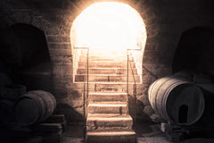 Wine cellar stone stairs leading up towards bright light Royalty Free Stock Photo