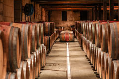 Wine Cellar Storage. Barrels of wine stored in a wine cellar located in St. Emilion France stock photo
