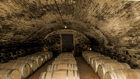 Wine Cellar in Tuscany Italy. Wine barrels in cellar in Tuscany Italy Stock Images