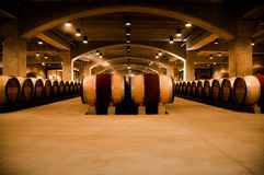 Wine cellar. A wine cellar at a vineyard aging wine in wooden barrels Stock Photo