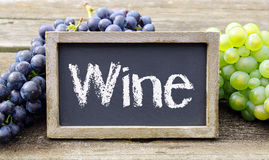 Wine chalkboard and grapes Royalty Free Stock Photo