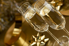 Wine. Champagne. Champagne in glasses on a yellow background Royalty Free Stock Photos