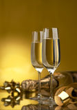Wine. Champagne. Champagne in glasses on a yellow background Royalty Free Stock Photography