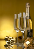 Wine. Champagne. Champagne in glasses on a yellow background Stock Images