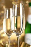 Wine. Champagne. Champagne in glasses on a yellow background Royalty Free Stock Image