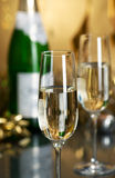Wine. Champagne. Champagne in glasses on a yellow background Royalty Free Stock Images