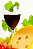 Wine and cheese. Red wine in fine glass with cheese and grape Stock Photos
