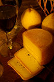 Wine and Cheese. Wine in glass, pear and cheese stock image