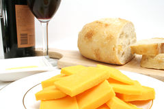 Wine and cheese. Isolated photo of wine and cheese on white Royalty Free Stock Images