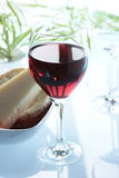 Wine and cheese. Glass of redwine with cheese in the background Stock Photos