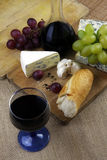 Wine and cheese. Romantic dinner with wine and cheese on rustic board Stock Photo