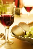 Wine and cheese. Glass of wine with pecorino cheese stock photo